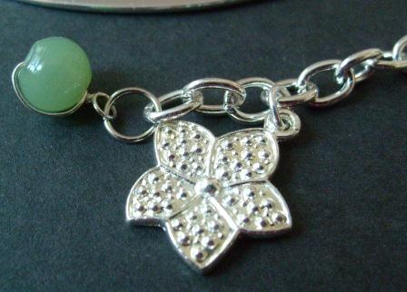 green bead and flower